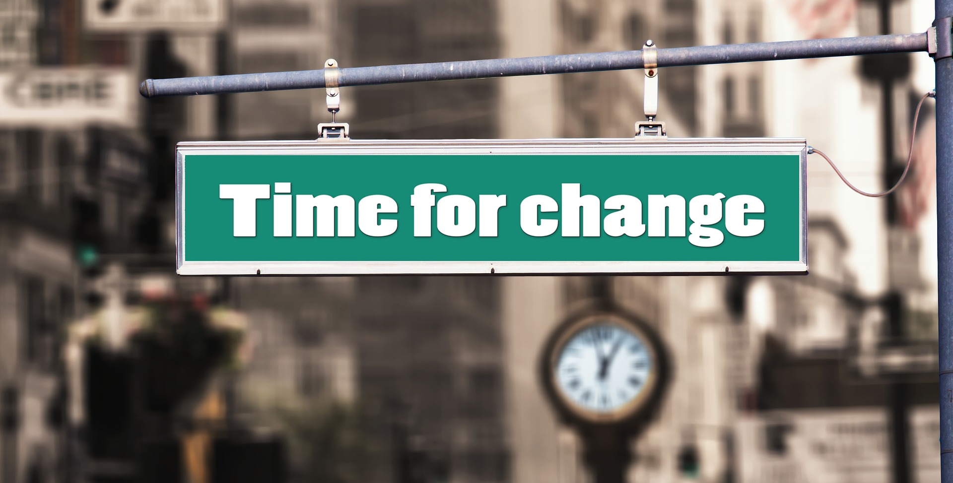 "street sign reading ""Time for change"""