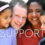 Support - multiracial family hugging and smiling