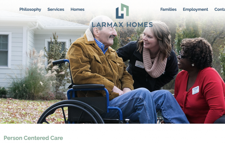 Larmax Homes screen shot - man in wheelchair, two women smiling at him